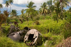 Wreck of Japanese Betty Bomber at end of one of the five airstrips built around Rabaul by the Japanese During WWII.